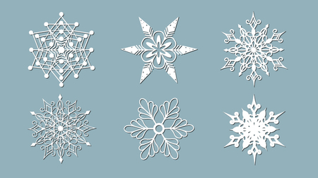 Set of snowflakes. Laser cut pattern for christmas paper cards, design elements, scrapbooking. Vector illustration. Vectores