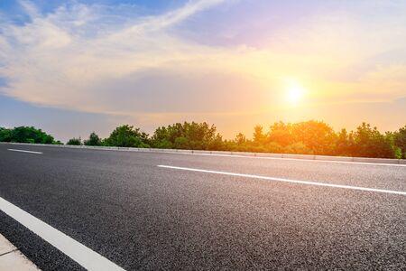 rural asphalt road scenery at sunset Imagens