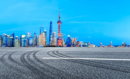 Shanghai urban architectural landscape and asphalt road at night Stock Photo
