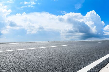 blue sky, whit clouds and asphalt road