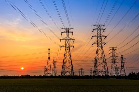 High voltage tower silhouette and sky landscape at dusk