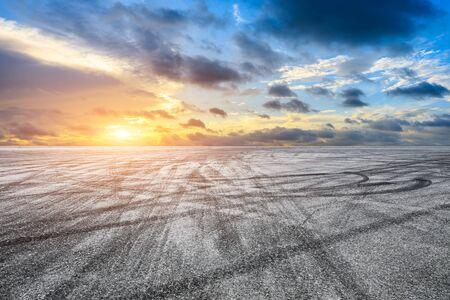 Empty asphalt road and sunset sky landscape in summer