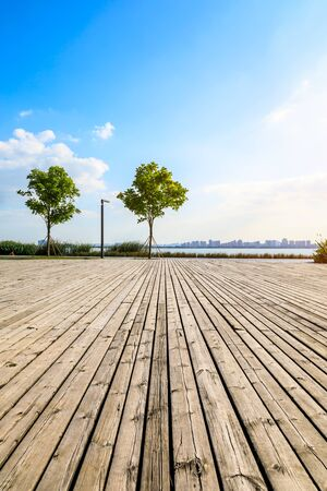 Empty wooden board square and city skyline in Suzhou