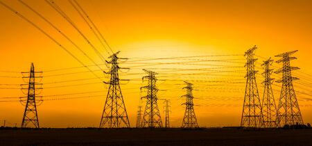 High voltage power tower and beautiful nature landscape at sunset Stockfoto