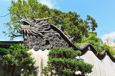 Dragon detail On the wall in Yuyuan Garden, Shanghai China photo
