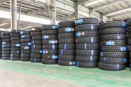 tire tread: Hangzhou, China - on July 24, 2015: North train station freight warehouse goods piled up many car tires, North train station is a large Cargo transfer station in hangzhou. Editorial