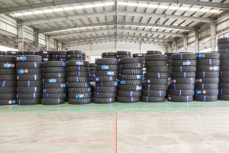 goods train: Hangzhou, China - on July 24, 2015: North train station freight warehouse goods piled up many car tires, North train station is a large Cargo transfer station in hangzhou. Editorial
