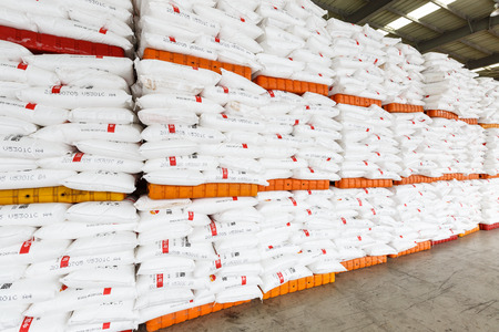 goods train: Hangzhou, China - on July 24, 2015: North train station freight warehouse goods piled up many Polyvinylchlorid products, North train station is a large Cargo transfer station in hangzhou.
