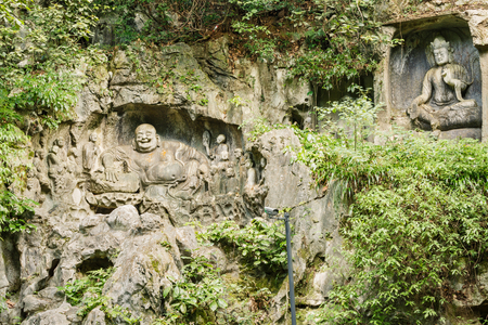scenic spots: Hangzhou, China - On September 9, 2015: Hangzhou Lingyin temple klippe stone carving of Buddha ,lingyin Temple klippe is one of the famous scenic spots in Hangzhou.