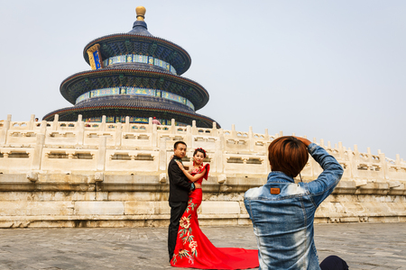 temple of heaven: Beijing, China - September 17, 2015: a pair of chinese newlyweds for their wedding photos in the temple of heaven park, the temple of heaven park is a famous tourist attraction in China.
