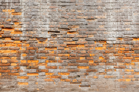 degradation: weathering and degradation old vintage brick wall