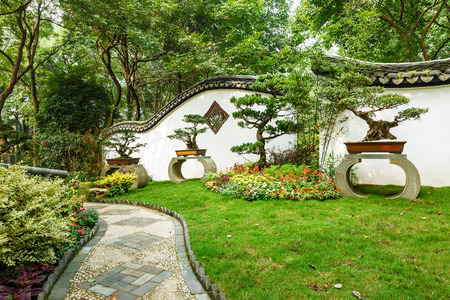 chinese courtyard: The beauty of the Chinese traditional gardens and green bonsai plants Stock Photo