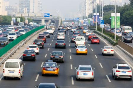 fuzzy: modern city traffic jam in the rush hour ,Fuzzy automotive background Stock Photo
