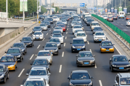 rush hour: modern city traffic jam in the rush hour ,Fuzzy automotive background Stock Photo