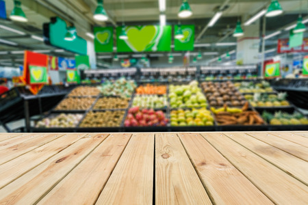 fuzzy: Wood table top and Supermarket fuzzy fruit background Stock Photo