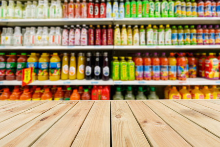 fuzzy: Wood table top and Supermarket fuzzy drinks background