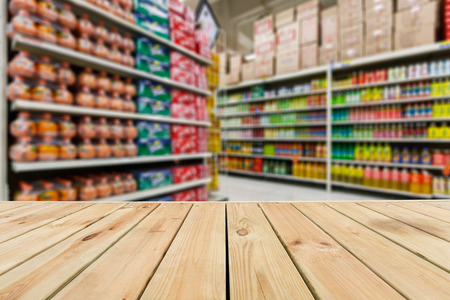 food shop: Wood table top and Supermarket fuzzy drinks background