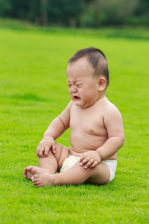 happy family nature: weeping Oriental baby in the park
