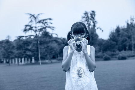 china people: Asian girl wearing mouth mask against air pollution