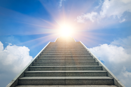 heaven background: concrete staircase going up into a bright light sky