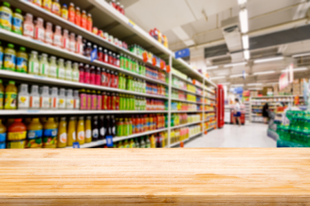 grocery shelves: Wood table top and Supermarket fuzzy drinks background