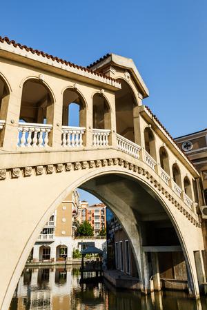 suburban: The old bridge beside the apartment building in suburban area