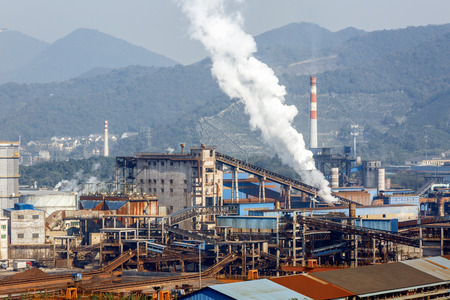 steelworks: Steel mills Smoke and powder dust pollution in large industrial District Stock Photo