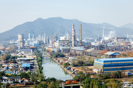 industrial district: Steel mills Smoke and powder dust pollution in large industrial District Stock Photo