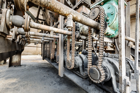 antique factory: Old gears and chain of industrial machinery parts Stock Photo
