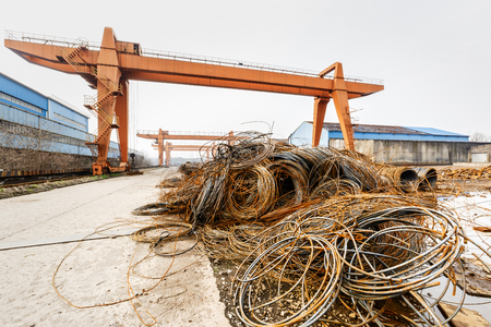 clutter: Pile up clutter rusty metal steel wire in Steel mills Stock Photo