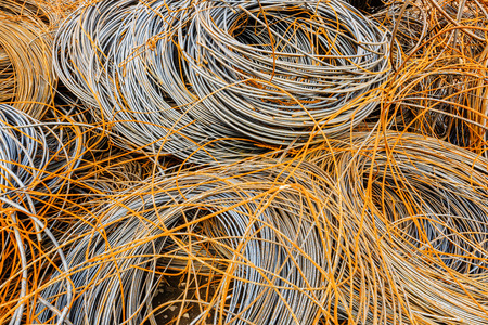 to pile up: Pile up clutter rusty metal steel wire in Steel mills Stock Photo