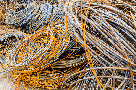 clutter: Pile up clutter rusty metal steel wire in Steel mills Stock Photo