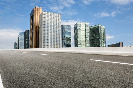 urban road: The modern urban commercial building and asphalt road