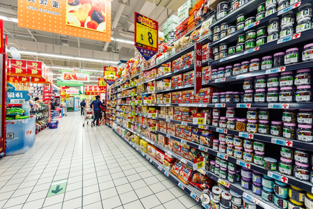 food shelf: Hangzhou, China - on March 23, 2016: Rt-mart Supermarket neatly placed in the interior of the food goods,Rt-mart supermarket is a large chain stores in Taiwan?