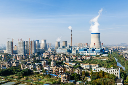 suburb: Industrial power plant smoke pollution in urban suburb