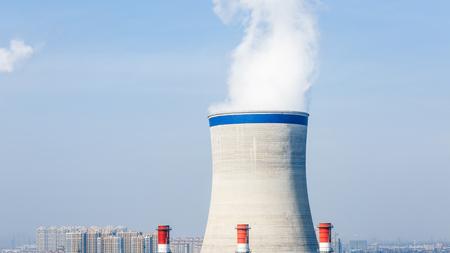 destructive: Industrial power plant smoke pollution, blue sky Stock Photo