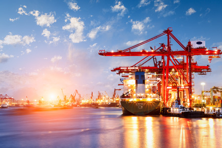 Industrial container freight Trade Port scene at sunset