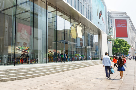 headquartered: Shanghai, China - on May 11, 2016: the apple store in nanjing road shopping street of Shanghai, the company is a high-tech company in the United States,Headquartered in cupertino, California. Editorial