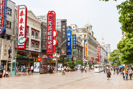 street signs: Shanghai, China - on May 11, 2016:Commercial shopping street scene in Nanjing Road,Nanjing Road is the main shopping street in Shanghai and one of the worlds busiest commercial streets. Editorial