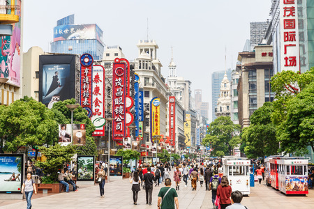 china people: Shanghai, China - on May 11, 2016:Commercial shopping street scene in Nanjing Road,Nanjing Road is the main shopping street in Shanghai and one of the worlds busiest commercial streets. Editorial