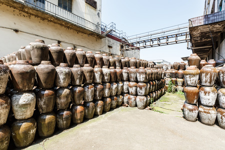 casks: Traditional Chinese rice wine container in distillery