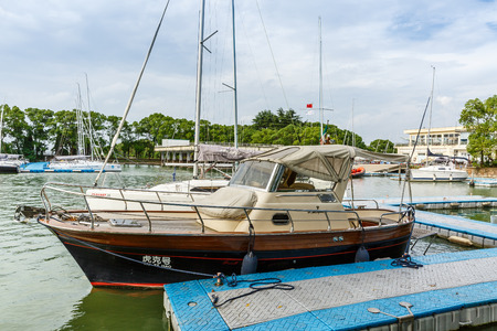 Shanghai,China - August 2,2016:Sailing boat moored at the pier Dianshan Lake,Shanghai Yacht Club was founded the sailing club by a group of sailing enthusiasts.