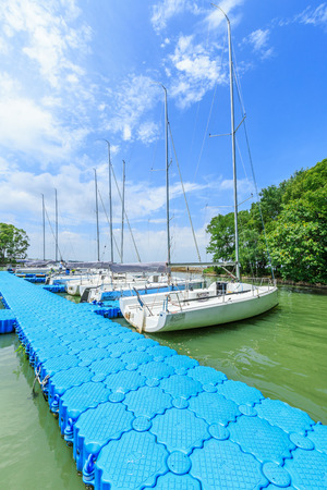Shanghai,China - August 2,2016:Sailing ship moored at the pier Dianshan Lake,Shanghai Yacht Club was founded the sailing club by a group of sailing enthusiasts.