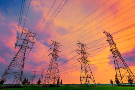 High voltage power tower scenery at sunset