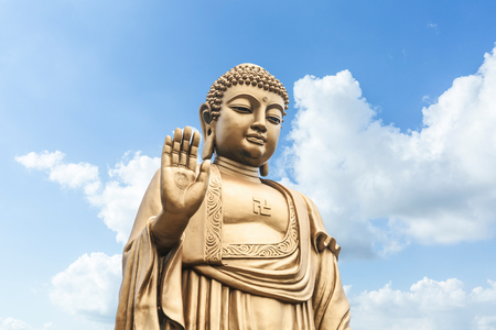 Buddha statue on the blue sky Stock Photo
