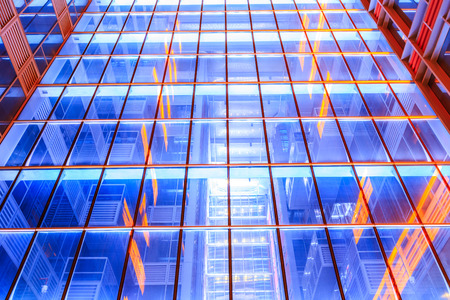 Modern skyscrapers glass wall in the evening
