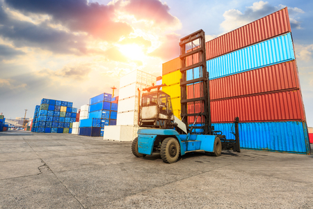 storage box: Industrial port container terminal at sunset Stock Photo