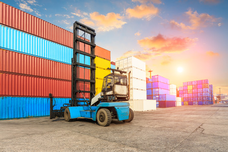 Industrial port container terminal at sunset Stock Photo