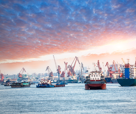 Industrial port cargo ships and cranes Stock Photo