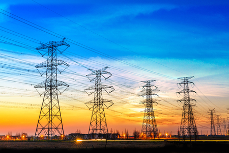 high voltage post,High voltage tower sky sunset background Stock Photo